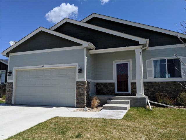 942 Settlers Drive, Milliken, CO 80543 (#4349947) :: The Healey Group