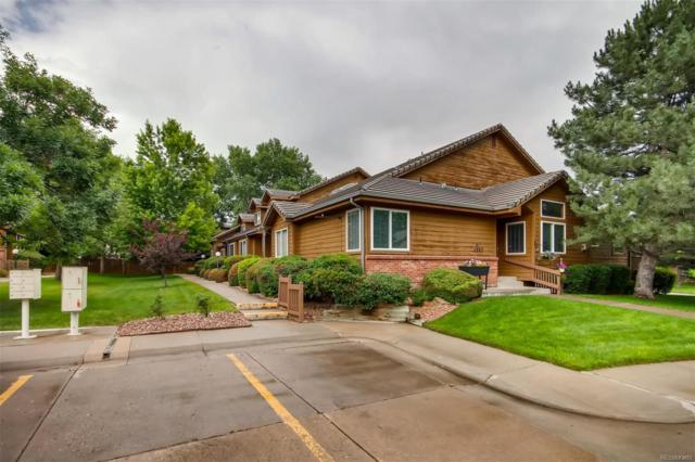 11865 W 66th Place C, Arvada, CO 80004 (#4401922) :: The Healey Group