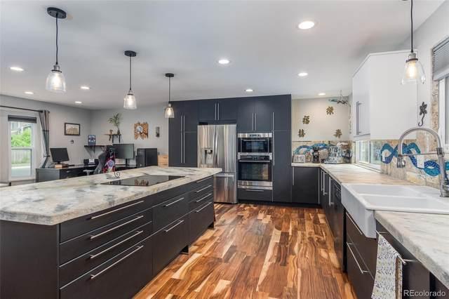 9875 W 81st Avenue, Arvada, CO 80005 (#4405605) :: HomeSmart