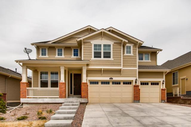 18875 W 84th Place, Arvada, CO 80007 (#4406686) :: The Peak Properties Group