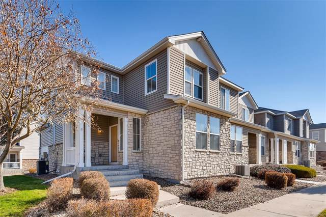 9758 Laredo Street 1A, Commerce City, CO 80022 (#4414422) :: HergGroup Denver