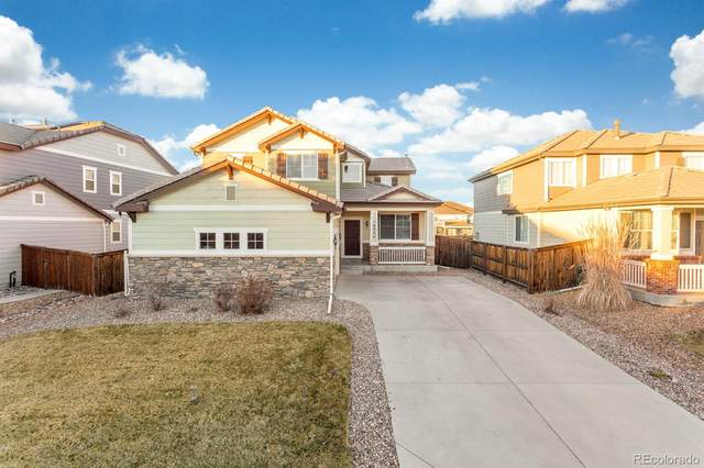 16035 E 107th Place, Commerce City, CO 80022 (#4420272) :: The DeGrood Team