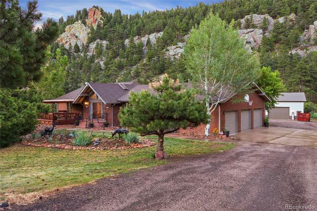 9476 Blue Mountain Drive, Golden, CO 80403 (#4424630) :: The DeGrood Team