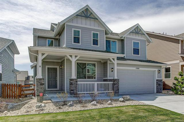 17018 W 87th Avenue, Arvada, CO 80007 (#4484170) :: The Peak Properties Group