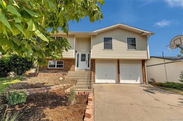 1855 E 98th Avenue, Thornton, CO 80229 (#4498437) :: The DeGrood Team