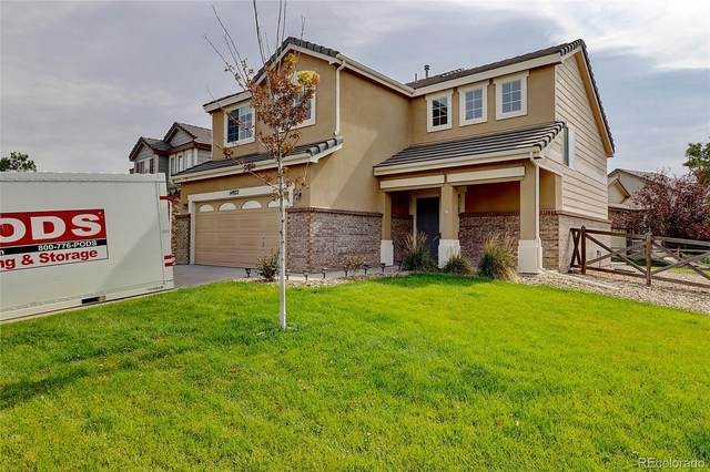 14922 E 119th Avenue, Commerce City, CO 80603 (#4516398) :: My Home Team