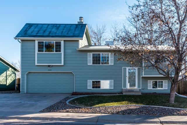 6026 S Garland Way, Littleton, CO 80123 (#4518107) :: The Griffith Home Team