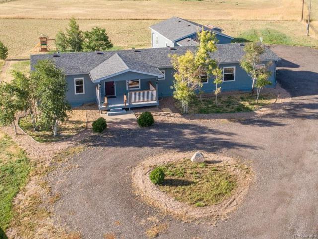 56600 E 32nd Avenue, Strasburg, CO 80136 (#4542964) :: Compass Colorado Realty