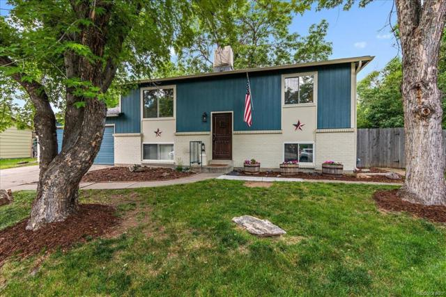 11874 W 71st Place, Arvada, CO 80004 (#4562906) :: The Dixon Group