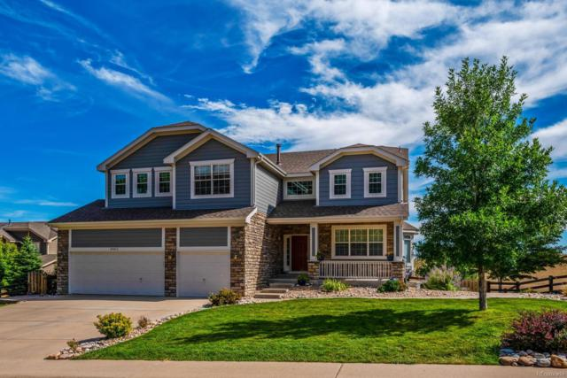6962 Blue Mesa Lane, Littleton, CO 80125 (#4603112) :: The City and Mountains Group