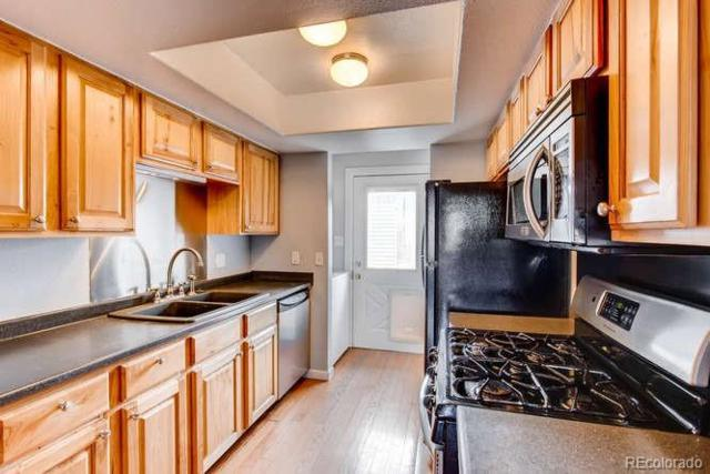12875 W Alameda Drive, Lakewood, CO 80228 (#4620071) :: The Peak Properties Group