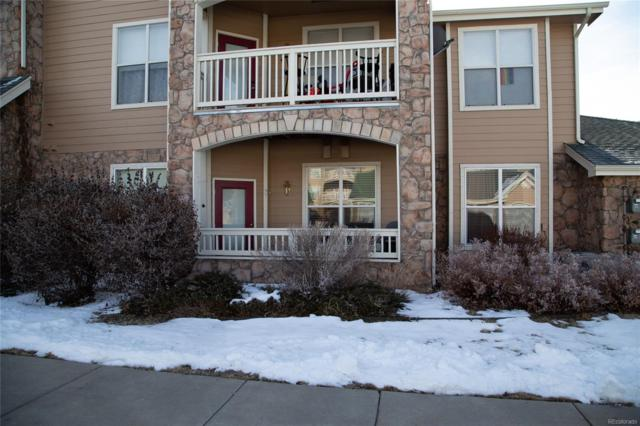 18930 E Warren Circle D-104, Aurora, CO 80013 (#4685633) :: The Dixon Group