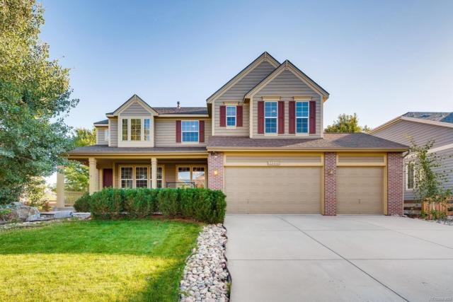 14220 W 86th Place, Arvada, CO 80005 (#4745004) :: The HomeSmiths Team - Keller Williams