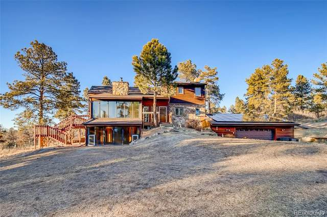 8237 Burning Tree Trail, Franktown, CO 80116 (#4746598) :: The Dixon Group