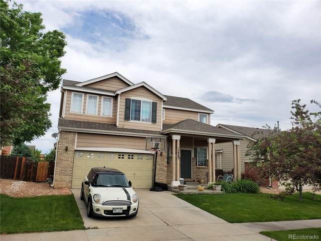 13883 E 104th Place, Commerce City, CO 80022 (#4760461) :: The Margolis Team