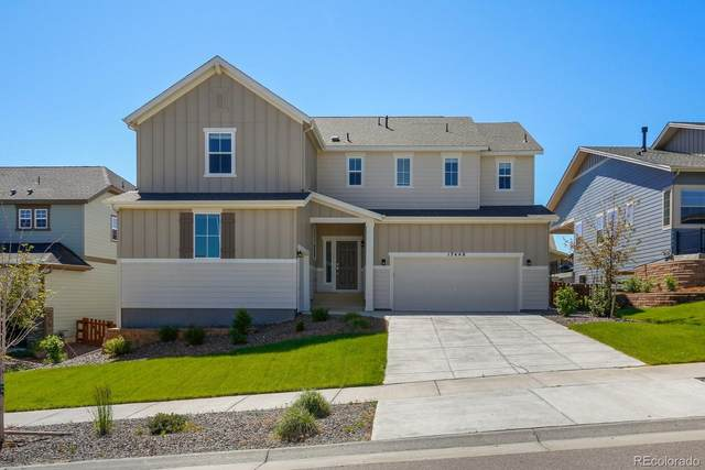 17448 W 95th Avenue, Arvada, CO 80007 (#4773399) :: The Healey Group