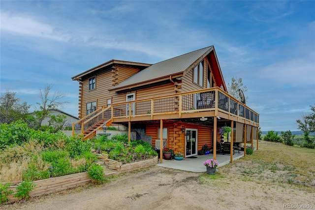 4930 Woodley Avenue, Sedalia, CO 80135 (#4800510) :: The Griffith Home Team