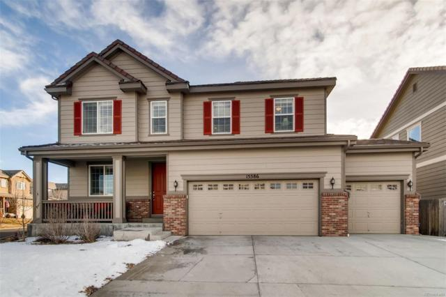 15586 E 118th Avenue, Commerce City, CO 80022 (#4801413) :: The Healey Group