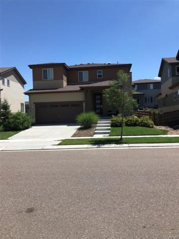 10110 Truckee Street, Commerce City, CO 80022 (#4862727) :: The Healey Group