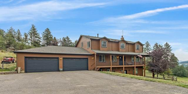 7540 S Homesteader Drive, Morrison, CO 80465 (#4874608) :: iHomes Colorado