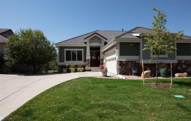 1983 Heritage Place, Erie, CO 80516 (#4879523) :: The Healey Group