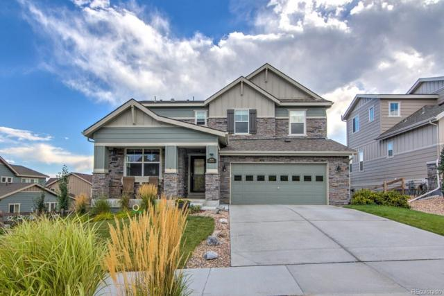 16286 W 94th Drive, Arvada, CO 80007 (#4880404) :: The Peak Properties Group