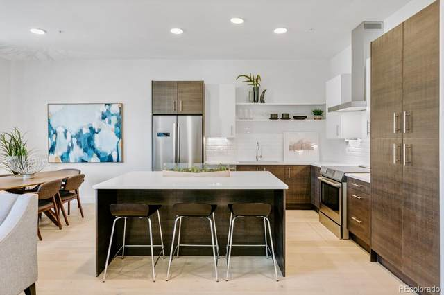 2570 Lawrence Street #203, Denver, CO 80205 (#4890324) :: Bring Home Denver with Keller Williams Downtown Realty LLC
