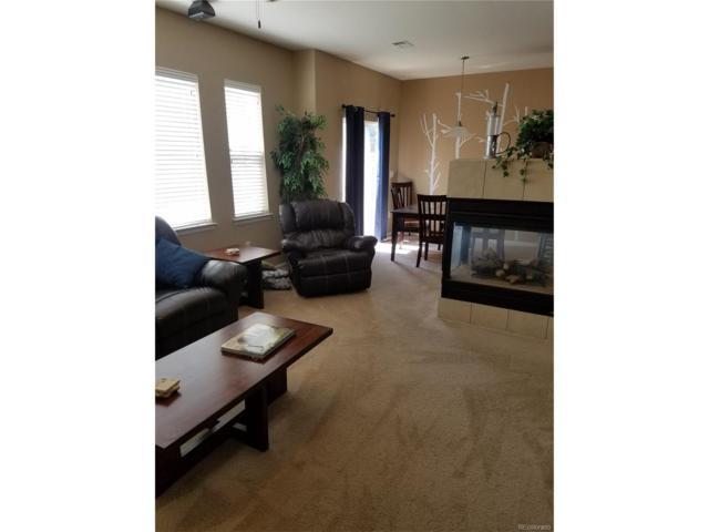 17920 E 104th Place F, Commerce City, CO 80022 (#4966986) :: Wisdom Real Estate