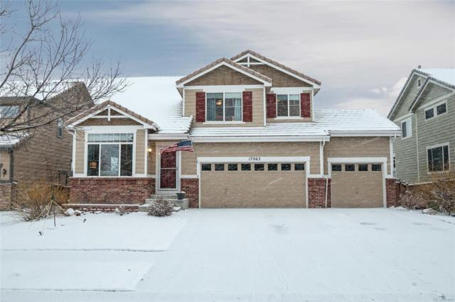 17063 E 104th Way, Commerce City, CO 80022 (#4987810) :: The Peak Properties Group