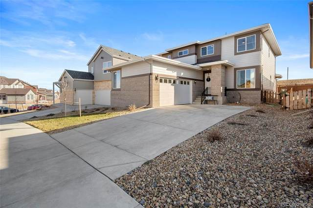 18640 W 92nd Drive, Arvada, CO 80007 (#4988937) :: Hudson Stonegate Team