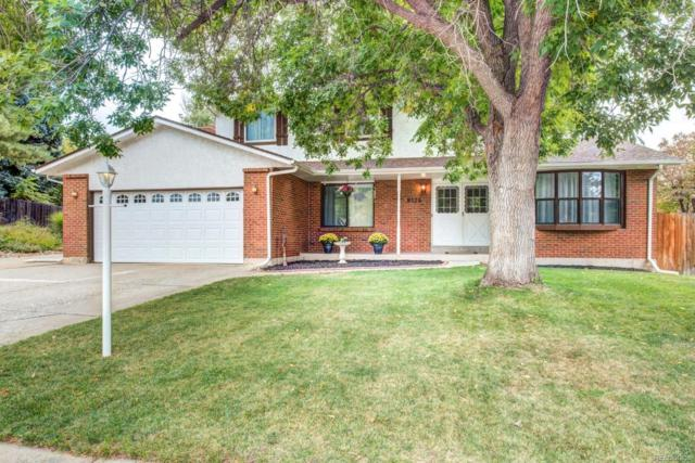 8124 Ammons Way, Arvada, CO 80005 (#5011121) :: The Galo Garrido Group