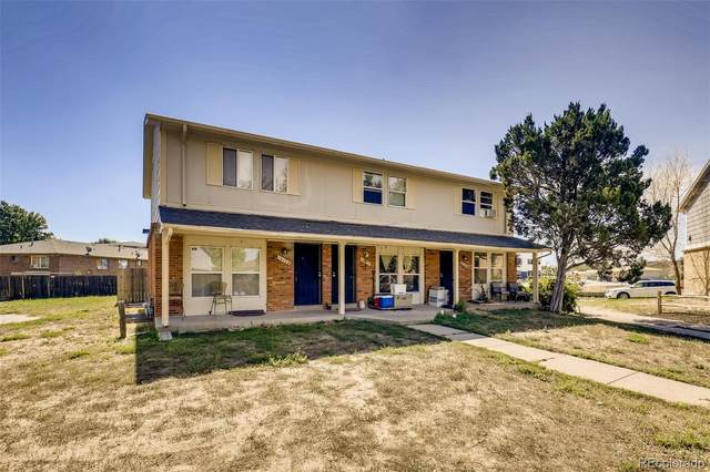 14168 E 22nd Place, Aurora, CO 80011 (#5017445) :: Compass Colorado Realty