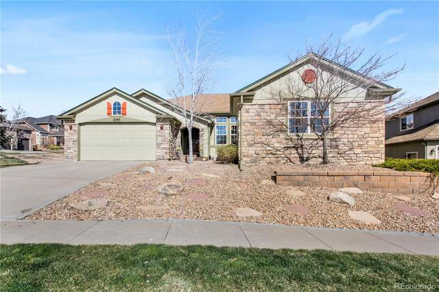 12495 W 77th Drive, Arvada, CO 80005 (#5024381) :: The Peak Properties Group
