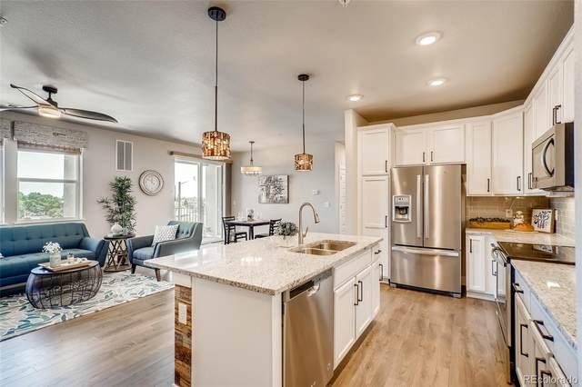 15274 W 64th Lane #302, Arvada, CO 80007 (#5036205) :: Kimberly Austin Properties