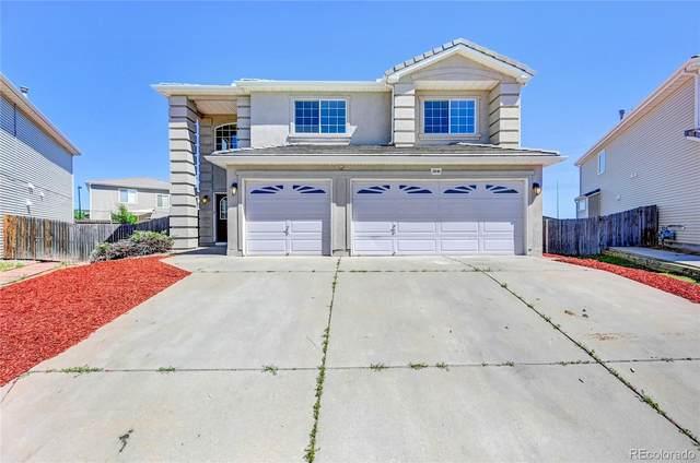 3840 Jebel Street, Denver, CO 80249 (#5056383) :: Portenga Properties