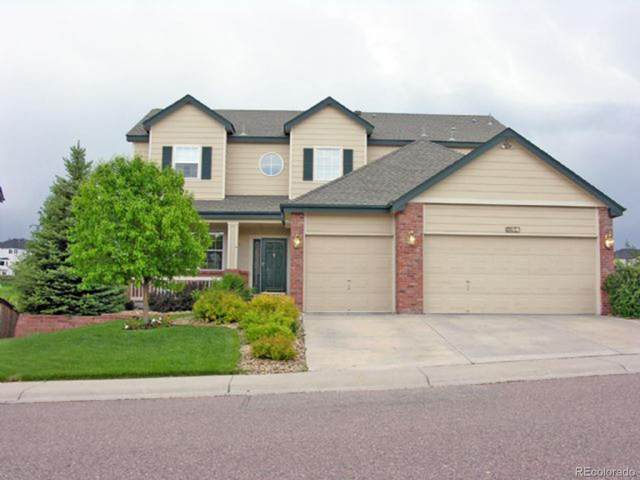 10616 Jaguar Point, Lone Tree, CO 80124 (#5061213) :: The Gilbert Group
