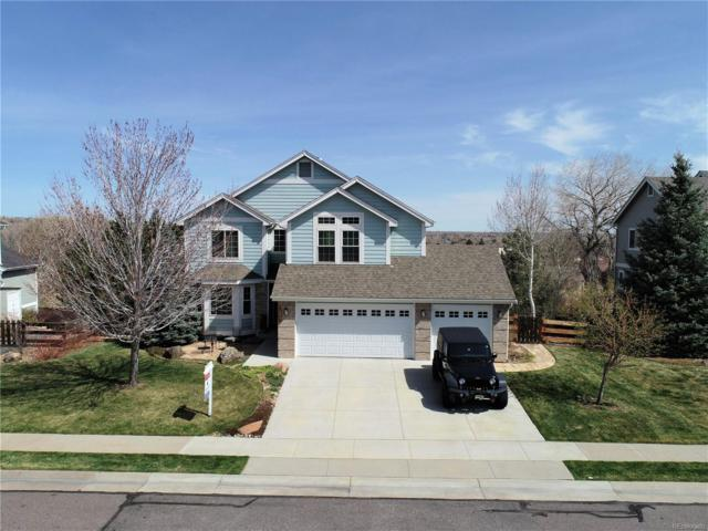 16827 W 62nd Place, Arvada, CO 80403 (#5101399) :: The Peak Properties Group