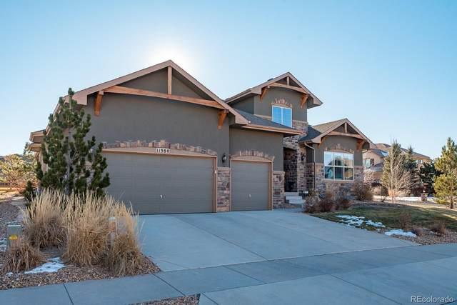 11980 S Longs Bluff Way, Parker, CO 80134 (#5103771) :: iHomes Colorado