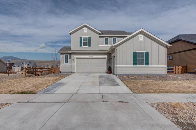 17335 W 94th Avenue, Arvada, CO 80007 (#5117169) :: The Peak Properties Group