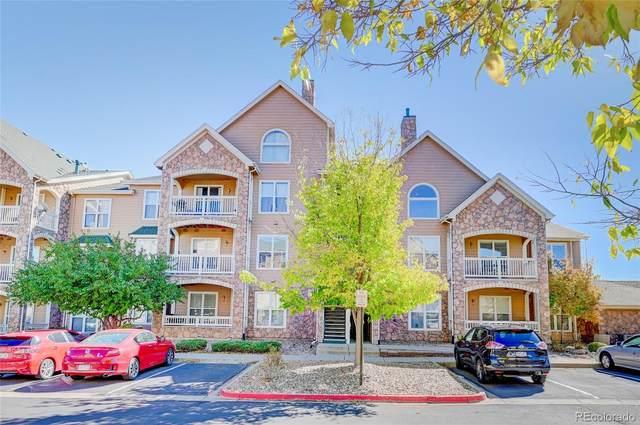 19049 E Warren Drive #306, Aurora, CO 80013 (#5246848) :: Portenga Properties