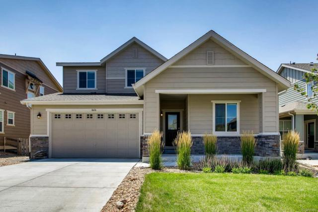 16616 W 94th Drive, Arvada, CO 80007 (#5277122) :: The Peak Properties Group