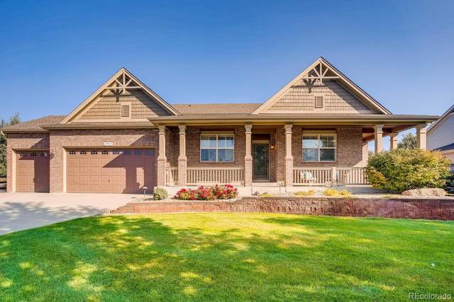 17973 W 77th Lane, Arvada, CO 80007 (#5315035) :: The DeGrood Team
