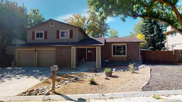 6954 W 83rd Avenue, Arvada, CO 80003 (#5353374) :: My Home Team