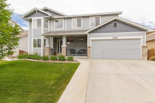 11242 Lima Street, Commerce City, CO 80640 (#5357015) :: The DeGrood Team