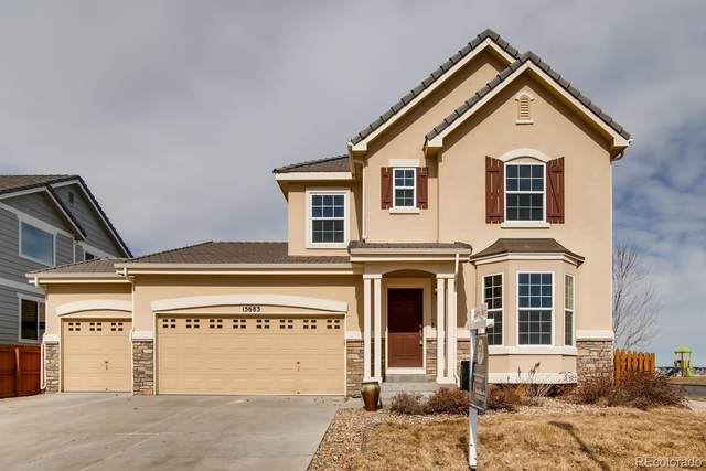 15683 E 117th Avenue, Commerce City, CO 80022 (#5379043) :: My Home Team