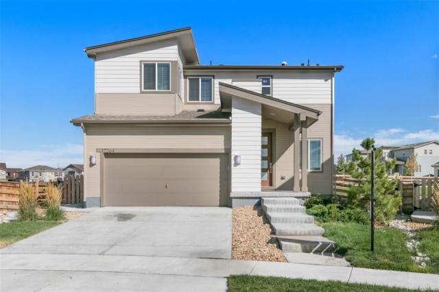 17264 E 110th Court, Commerce City, CO 80022 (#5393609) :: The Peak Properties Group