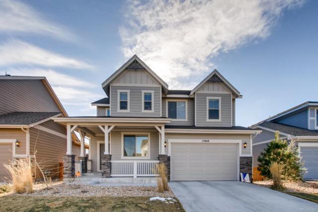 17048 W 87th Avenue, Arvada, CO 80007 (#5417019) :: House Hunters Colorado