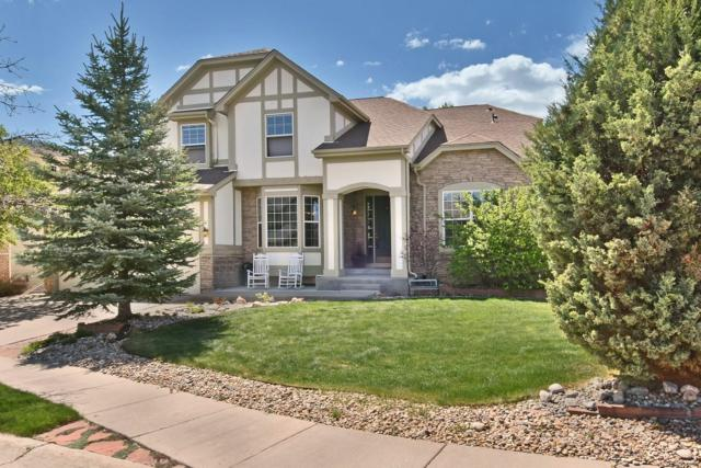 13444 W 86th Drive, Arvada, CO 80005 (#5467658) :: The Healey Group