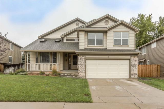 12487 W Aqueduct Drive, Littleton, CO 80127 (#5510442) :: The DeGrood Team