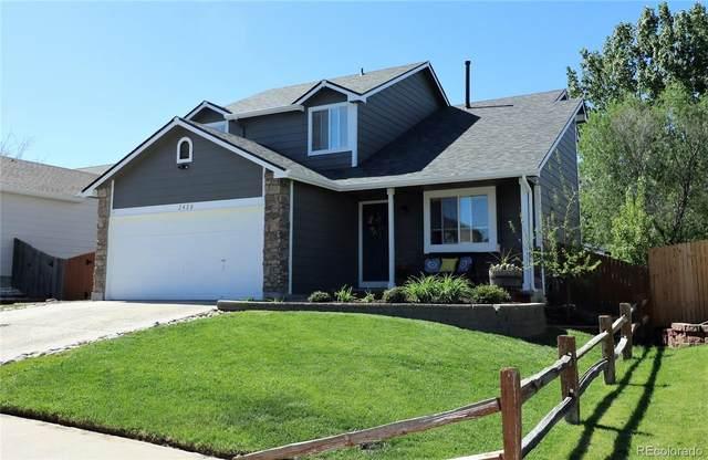 2428 Wolf Creek Drive, Brighton, CO 80601 (#5527733) :: Briggs American Properties
